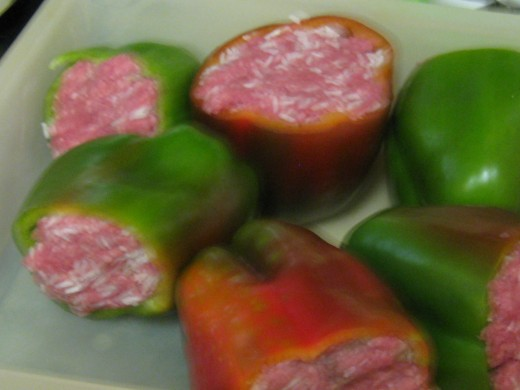 Whole Stuffed Green Peppers ready for freezing or cooking.