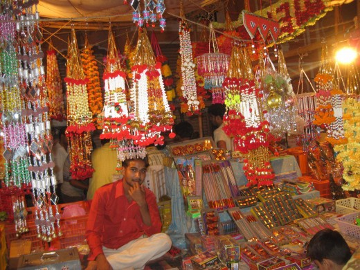 Shopkeeper selling Decorative items on Dhan Teras
