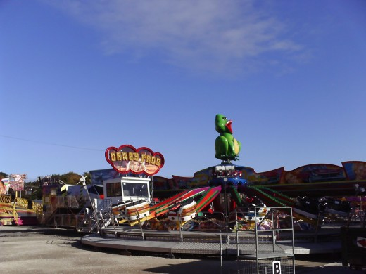 Wide shot of a few rides at Hull Fair and a frog on one of the rides...cheeky!