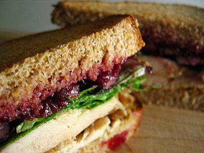 Here's a delicious variation of the Cuban Sandwich. In it you have whole berry cranberry sauce, cream cheese , lettuce , tomato , and thinly sliced turkey along with salt and pepper to taste.