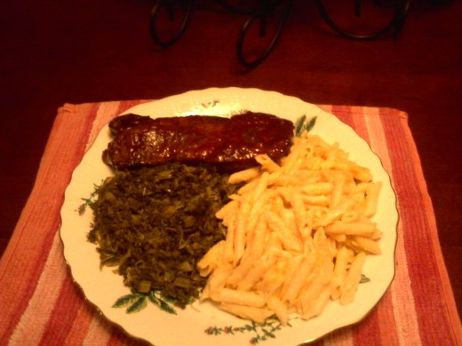 Sassy Ribs served with macaroni & cheese and mixed greens