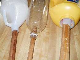 Each bottle will have a different size opening in the top spout. I try to find a pole or stick that is just a little smaller than the bottle opening so that I can fit the bottle on to the stick with ease. The pole can be metal or wood or very sturdy