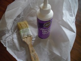 Use a wide flat brush and some white paper glue to mix up a paste of glue and acrylic paint.