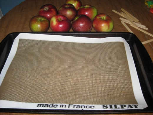 A silpat is a type of non stick pad. It works like wax paper and is great for baking and perfect for keeping the hot caramel from sticking to the pan.