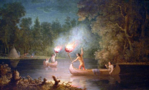 Menominees spearfishing at night by torchlight and canoe. The Menominee lived on fish, game and wild rice, making them well known as the Wild Rice People. Then they became lumbermen.(Photos public domain).
