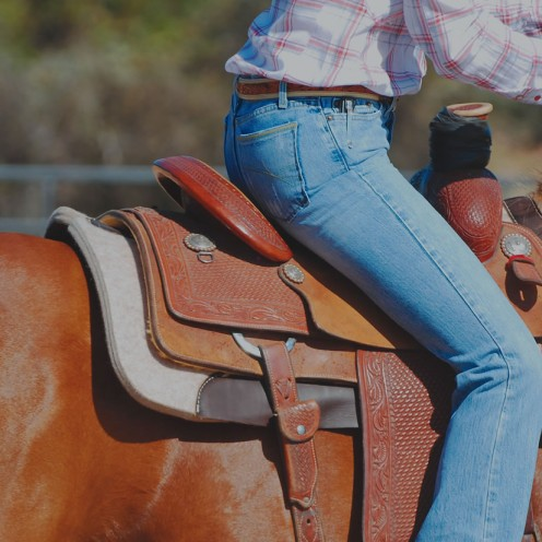 "This is a picture of a 32"" length saddle pad.  A smaller roping saddle is being used in this picture."