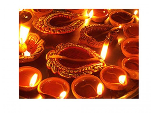 Traditional clay lamps called diwas are palced at doors and windows throughout the festival of diwali.