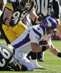 Pittsburgh Steelers linebacker James Harrison (92) sacks Minnesota Vikings quarterback Brett Favre (4) with the help of defensive end Brett Keisel (99) in the first quarter of an NFL football game in Pittsburgh, Sunday, Oct. 25, 2009. (AP Photo/Gene
