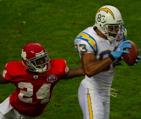 San Diego Chargers wide receiver Vincent Jackson (83) catches a touchdown pass in front of Kansas City Chiefs cornerback Brandon Flowers (24) during the first half of an NFL football game Sunday, Oct. 25, 2009, in Kansas City, Mo. (AP Photo/Charlie R