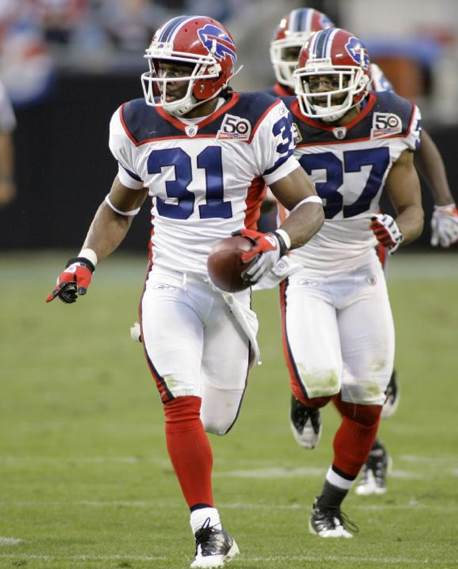 Buffalo Bills' Jairus Byrd (31) runs the ball after an interception with teammate George Wilson (37) against the Carolina Panthers in the second half of an NFL football game in Charlotte, N.C., Sunday, Oct. 25, 2009.  (AP Photo/Rick Havner)