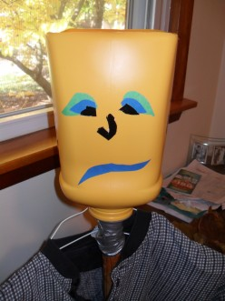 This face was added with different colors of adhesive tape. I used duct tape and painters masking tape because that was what I had on hand.