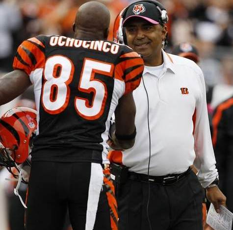 Bengals head coach Marvin Lewis shakes hands with Chad Ochocinco in the first quarter. The Enquirer/Jeff Swinger