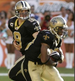 New Orleans Saints quarterback Drew Brees (9) hands off to running back Pierre Thomas during the second quarter of an NFL football game between the Miami Dolphins and the New Orleans Saints Sunday, Oct. 25, 2009 in Miami. (AP Photo/Jeffrey M. Boan)