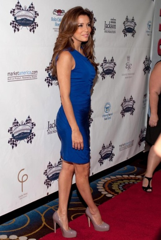 Eva Longoria in a little blue dress dress and platform high heels