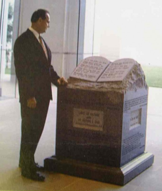 Alabama's Chief Justice, Roy Moore, shown here with the monument he refused to remove from the Alabama Supreme Court Building.