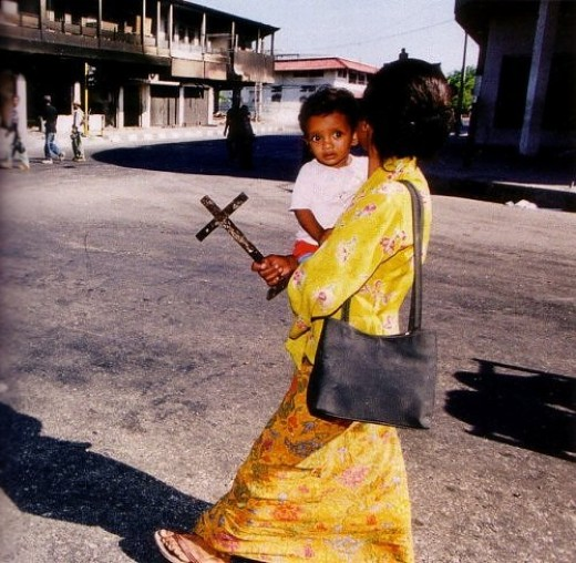 Ambon Woman and her son on the way to the church during Ambon's riot (1999)