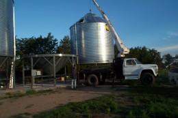 """With a boom truck and an operator who is never on time,    We move the bins into place    On the hoppers."" [These last two bins were new, but at the same location.]"