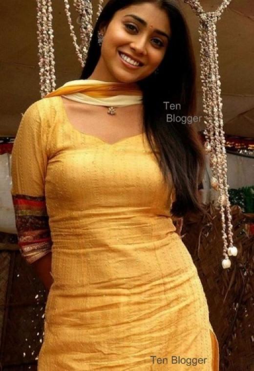 Shreya Sharan looks glowing in the golden Salwar Kameez.