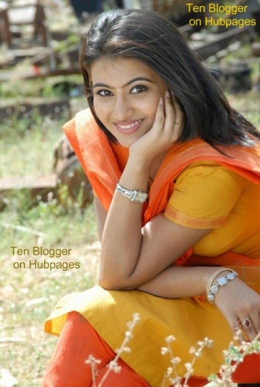 Aarthi in exclusive yellow orange Salwar Kameez