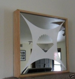 Two Way Mirror Shadow Box Spy/Surveillance Hidden Cam, picture courtesy of ebay seller http://myworld.ebay.com/oceanside57_57/