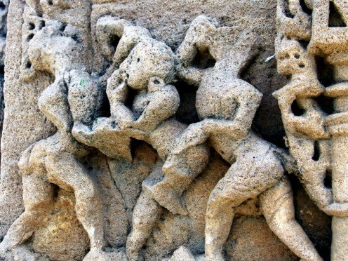 Husband tries to dis-engage  two women  engaged in a fight ...One is pulling hair of the other. 'Torana'(Arch),12th century.Vadnagar,Gujarat.