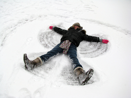 It's impossible to feel sad when you're making a snow angel.  Photo courtesy of:  http://www.flickr.com/photos/dalechumbley/3123442998/
