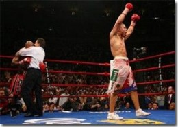 Cotto celebrating his victory over Zab Judah