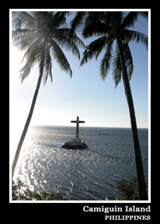 The White Cross over the Sunken Cemetery (http://www.lakwatsero.com/2008/03/29/camiguin-island/)
