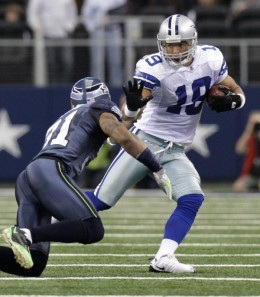 Dallas Cowboys WR Miles Austin (19) attempts to get around  Seahawks cornerback Ken Lucas, left, after making a reception in the first half 11/01/09 in Arlington, Texas. (AP Photo/LM Otero)