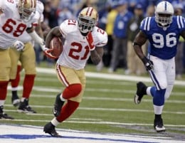 San Francisco 49ers running back Frank Gore (21) gets past Indianapolis Colts defensive tackle Keyunta Dawson, right, on the way to a 63-yard touchdown in the first quarter of an NFL football game in Indianapolis, Sunday, Nov. 1, 2009. (AP Photo/Mich