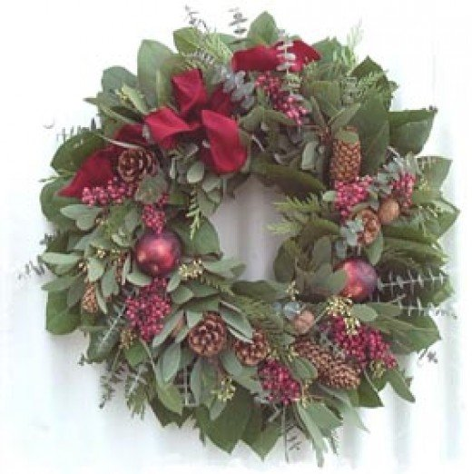 Eucalyptus leaves, pine cones, jeweled crab-apples and magnolias help make this wreath especially beautiful