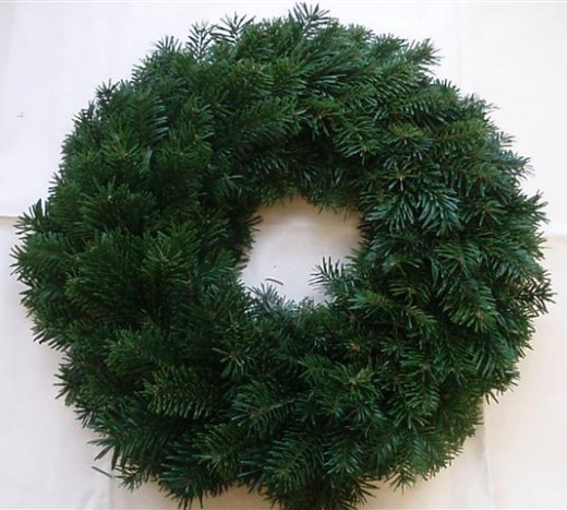 Start with a lush, full wreath as a base for your creation...