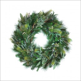 Begin by adding magnolia leaves for contrast, along with some holly and eucalyptus...