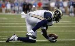 St. Louis Rams safety James Butler intercepts a Detroit Lions Matthew Stafford pass in the second quarter of an NFL football game in Detroit, Sunday, Nov. 1, 2009. Butler was tackled in the endzone for a safety on the play. (AP Photo/Paul Sancya)