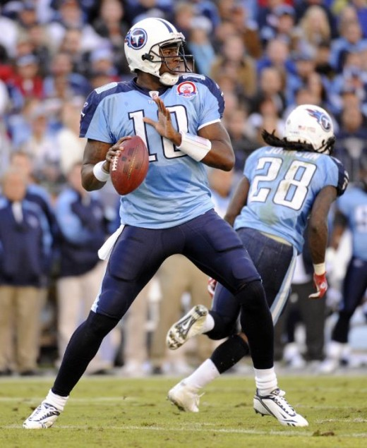 Tennessee Titans quarterback Vince Young (10) looks for a receiver as he plays against the Jacksonville Jaguars in the first quarter of an NFL football game in Nashville, Tenn., Sunday, Nov. 1, 2009. (AP Photo/John Russell)
