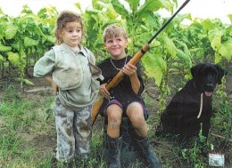 Oh my gosh!  Does that little boy even realize that he is handling his rifle safely?  He couldn't have been taught that.