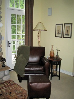 A brown leather chair adds warmth.