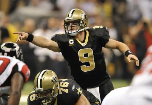 New Orleans Saints quarterback Drew Brees (9) cals a play against the Atlanta Falcons in the first half of an NFL football game in New Orleans, Monday, Nov. 2, 2009. [ (AP Photo/Bill Feig)