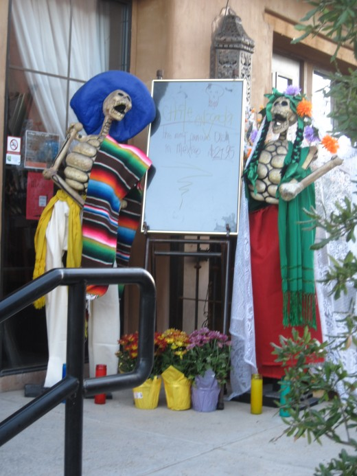 Dia de los Muertos skeletons in traditional Mexican attire