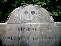 The common carving of a winged skull found in the cemetery.