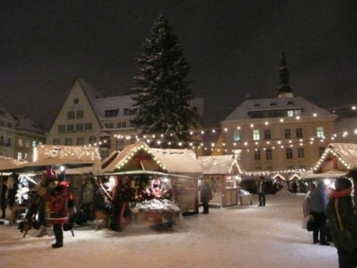 The snowy town hall square during christmas