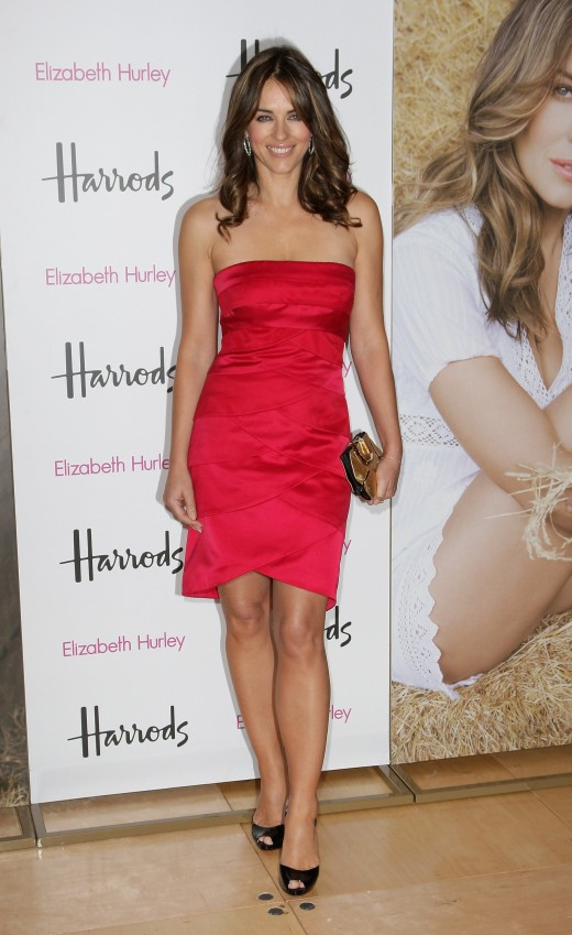 Elizabeth Hurley is a hot celebrity in a red minidress at the launch of her own organic food at Harrods London