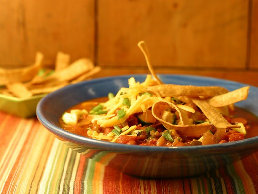 You can garnish your Worlds Best Vegetarian Chili with taco chips , shredded cheddar cheese and fine diced green onions.