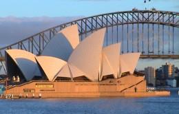 Sydney Opera House with The Sydney Harbor Bridge in the background.