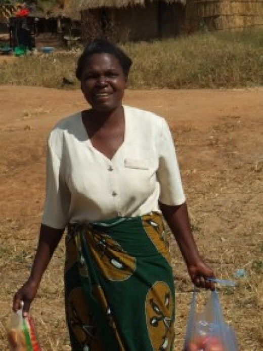 Judith Ngoma carries some of her produce to market.