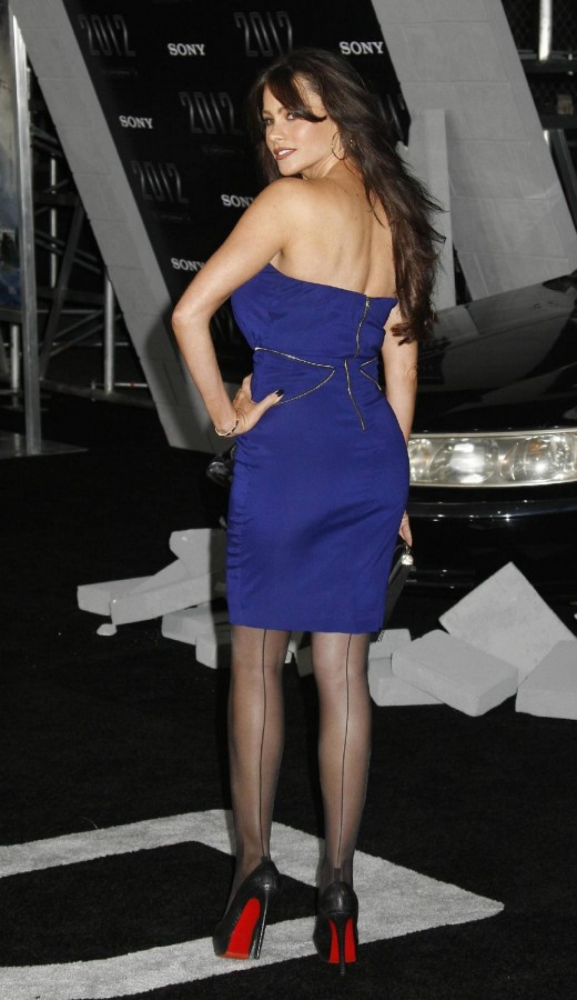 Sofia Vergara in a blue dress, Christian Louboutin high heels and stockings.