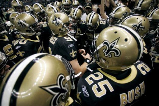 New Orleans Saints quarterback Drew Brees (9) leads his team in a pregame cheer before their NFL football game against the Carolina Panthers in New Orleans, Sunday, Nov. 8, 2009. (AP Photo/Dave Martin)