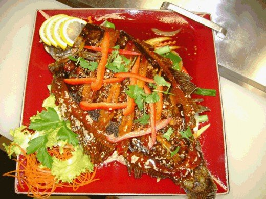 Chuu Chee Tilapia is a distinctly Thai Fish dish served in Thailand and Thai Restaurants in the USA.