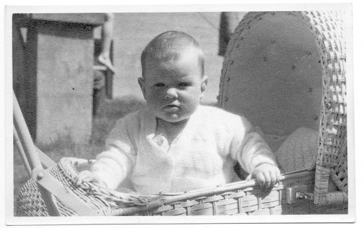 The baby is me, and the pram was a classic. Everyone had a cane pram.