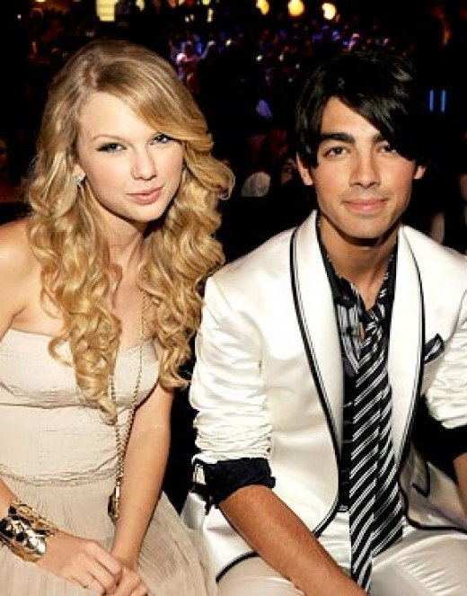 Taylor Swift and Joe Jonas attend an awards show in happier times.This was before Joe Jonas dumped Taylor Swift in a 27-second phone call.